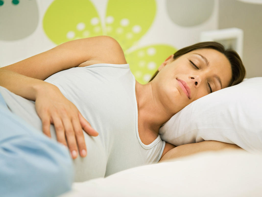 Woman sleeping during pregnancy